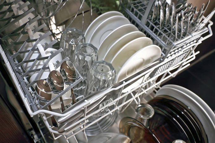Clean dishes, glasses, and utensils in a dishwasher.