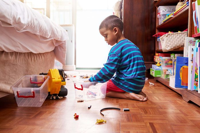 Young boy playing with toys.