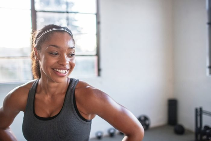 smiling woman during exercise workout