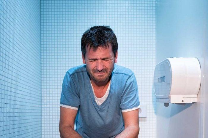 Man straining to poop