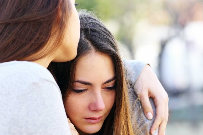 woman hugging and consoling upset woman
