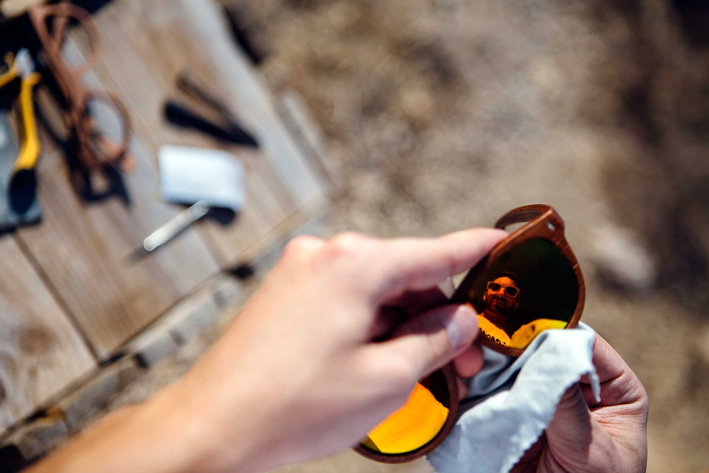 hands cleaning sunglasses