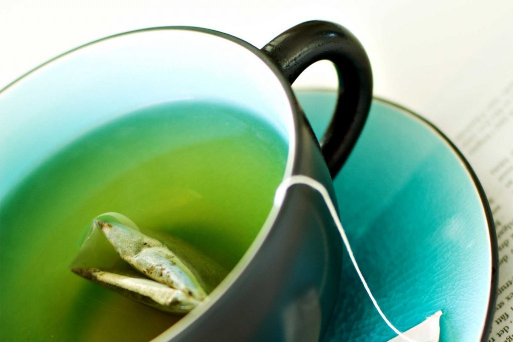 mug of green tea with tea bag