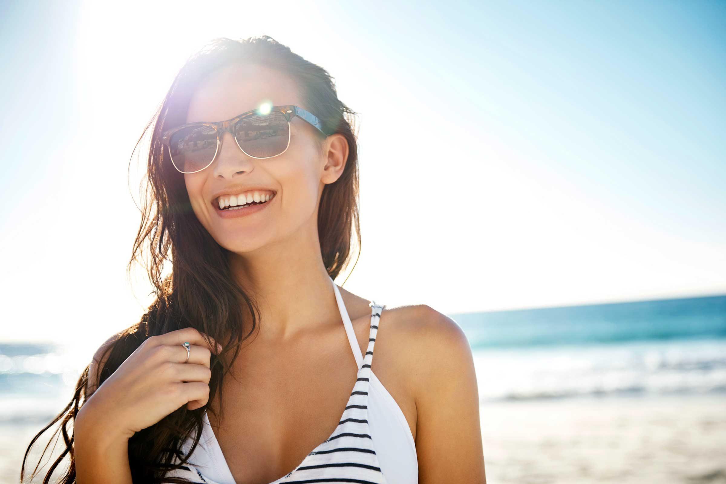 woman wearing sunglasses at beach