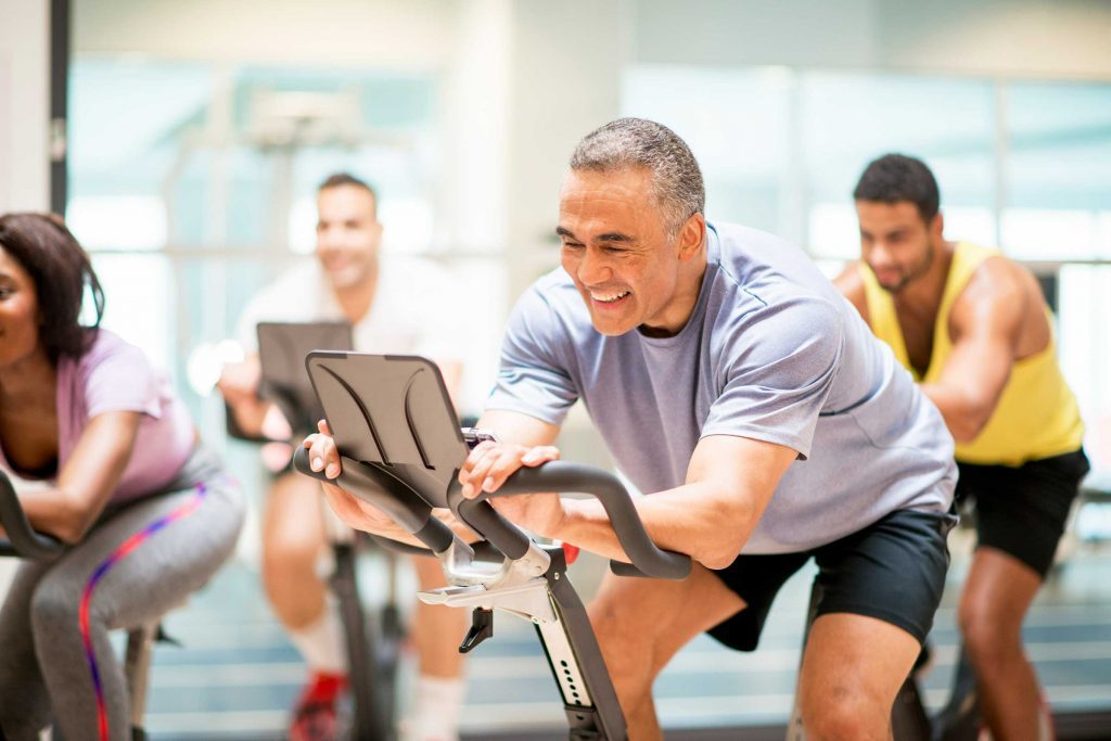 man in a spin class smiling