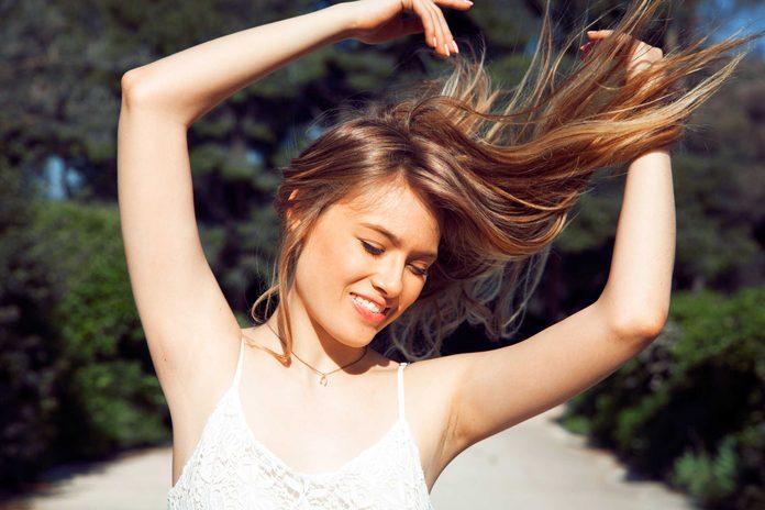 happy woman, long hair flying in wind