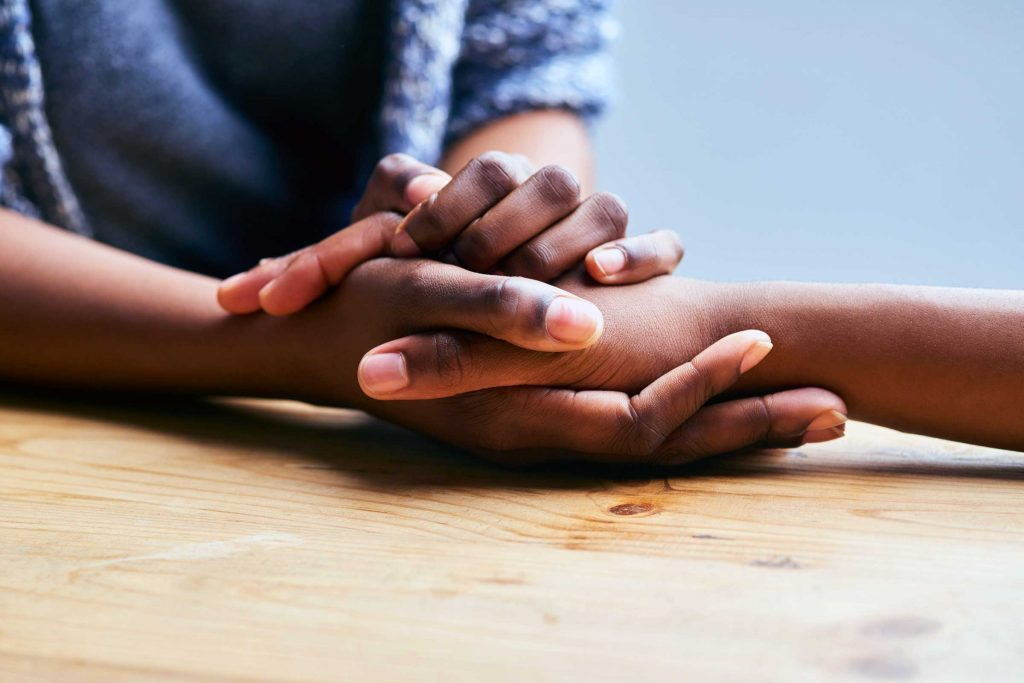 Close-up of hands holding another hand