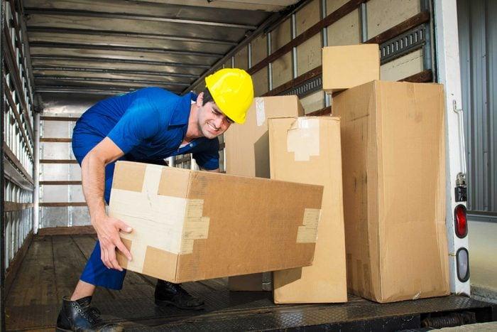 man lifting big box