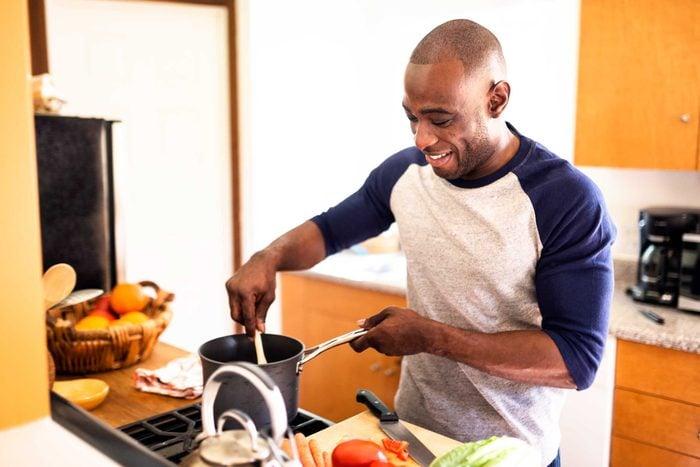 man cooking on stovetop