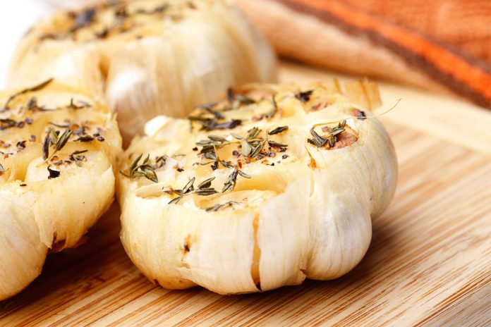 head of roasted garlic with spices