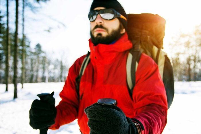 man wearing sunglasses in snow