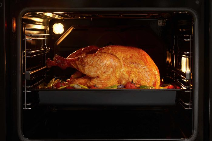turkey roasting in an oven