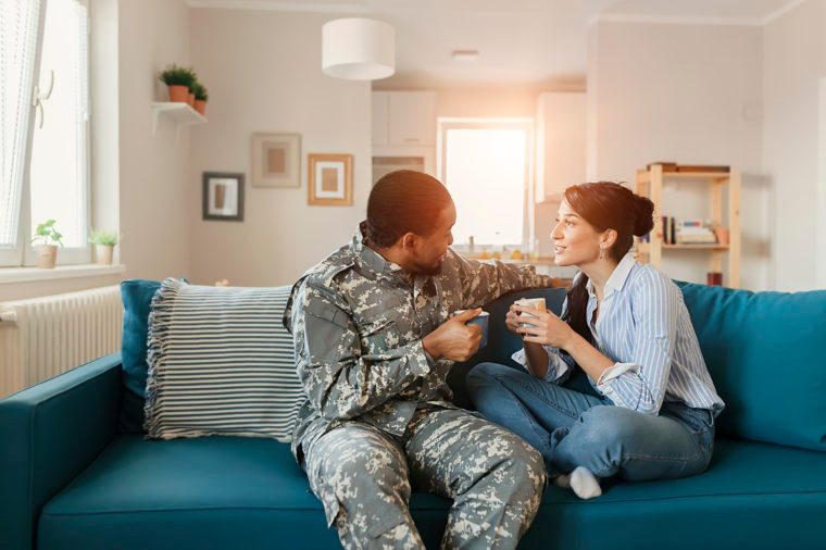 woman and military man couple talking at home good listener