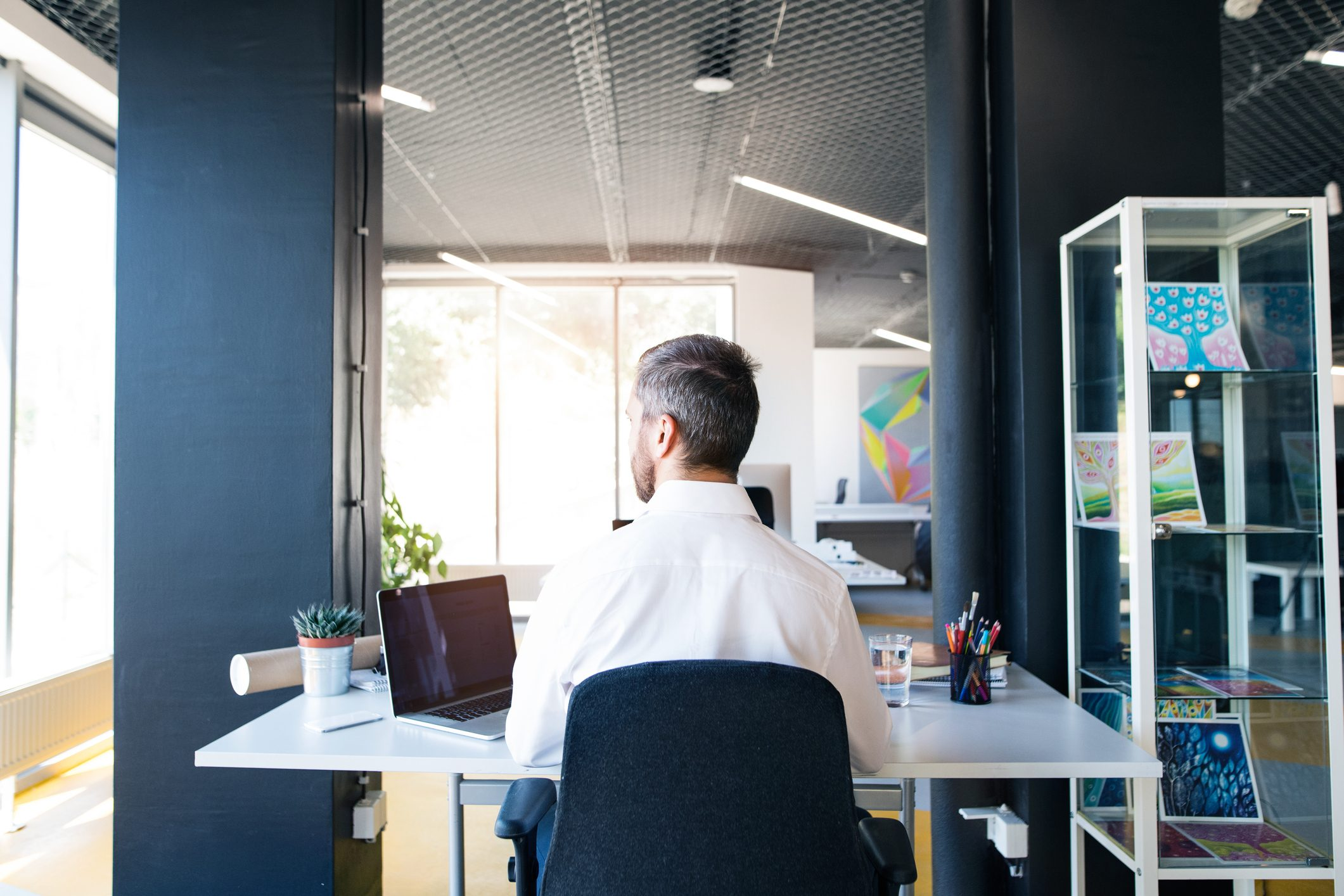 businessman sitting at desk working