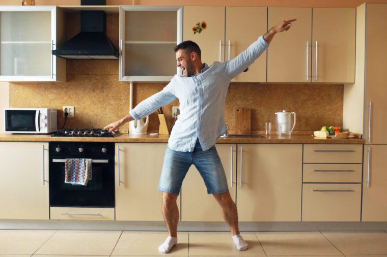 young man dancing in kitchen