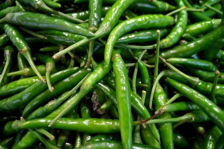 Group of green chili peppers