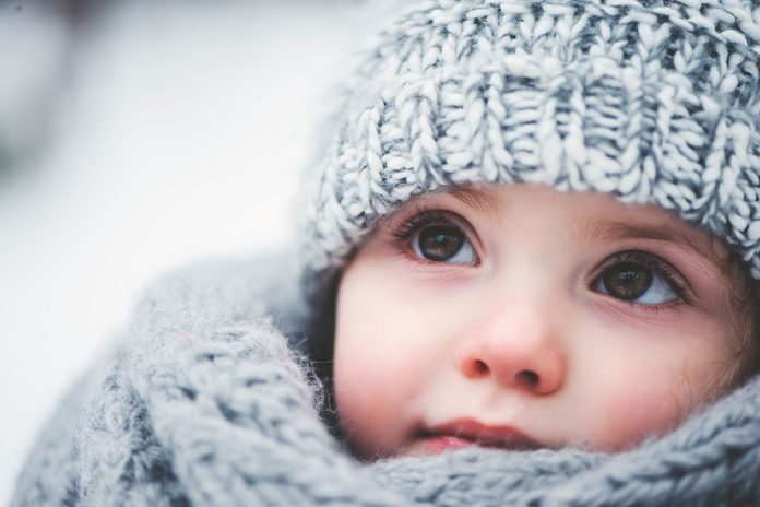 adorable toddler with crocheted hat and scarf
