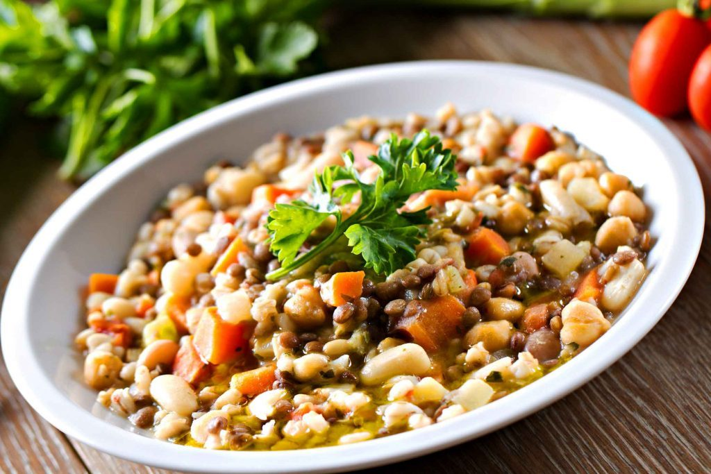 bowl of lentil soup with carrots and parsley on top