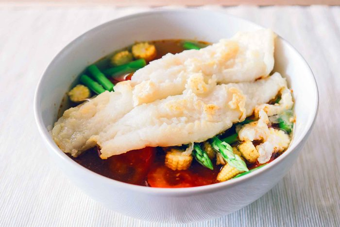filet of white fish on top of vegetables