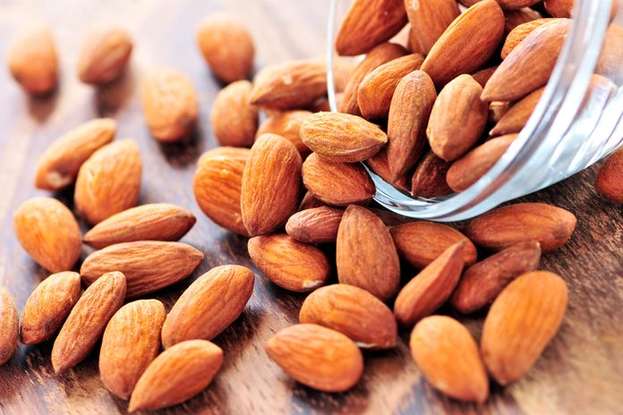 almonds spilling out of a glass dish