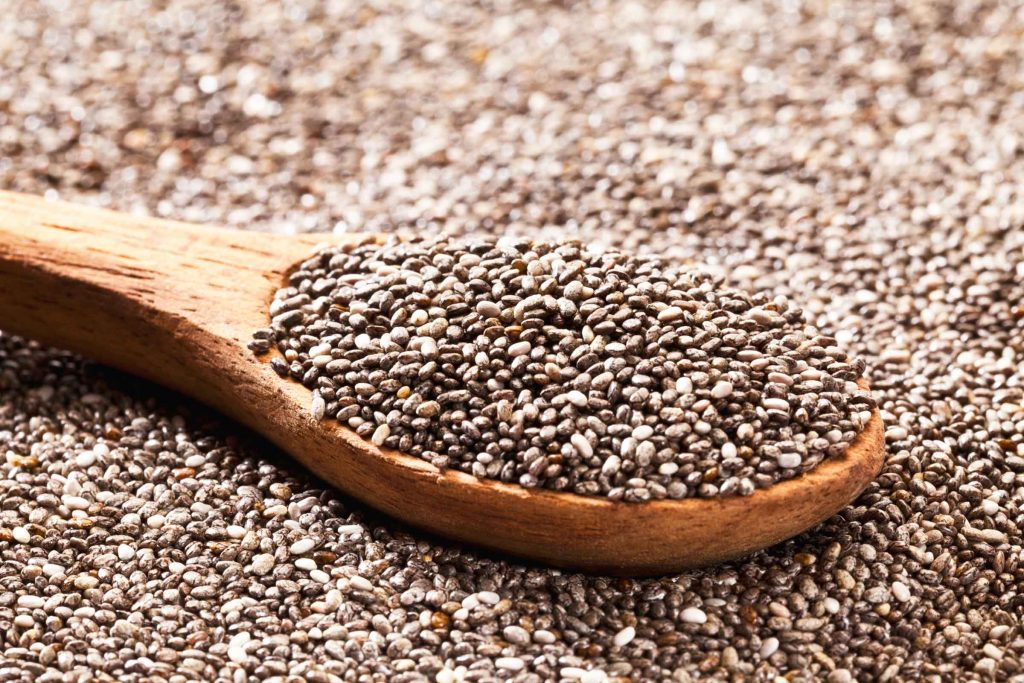 dried chia seeds with a wooden spoonful