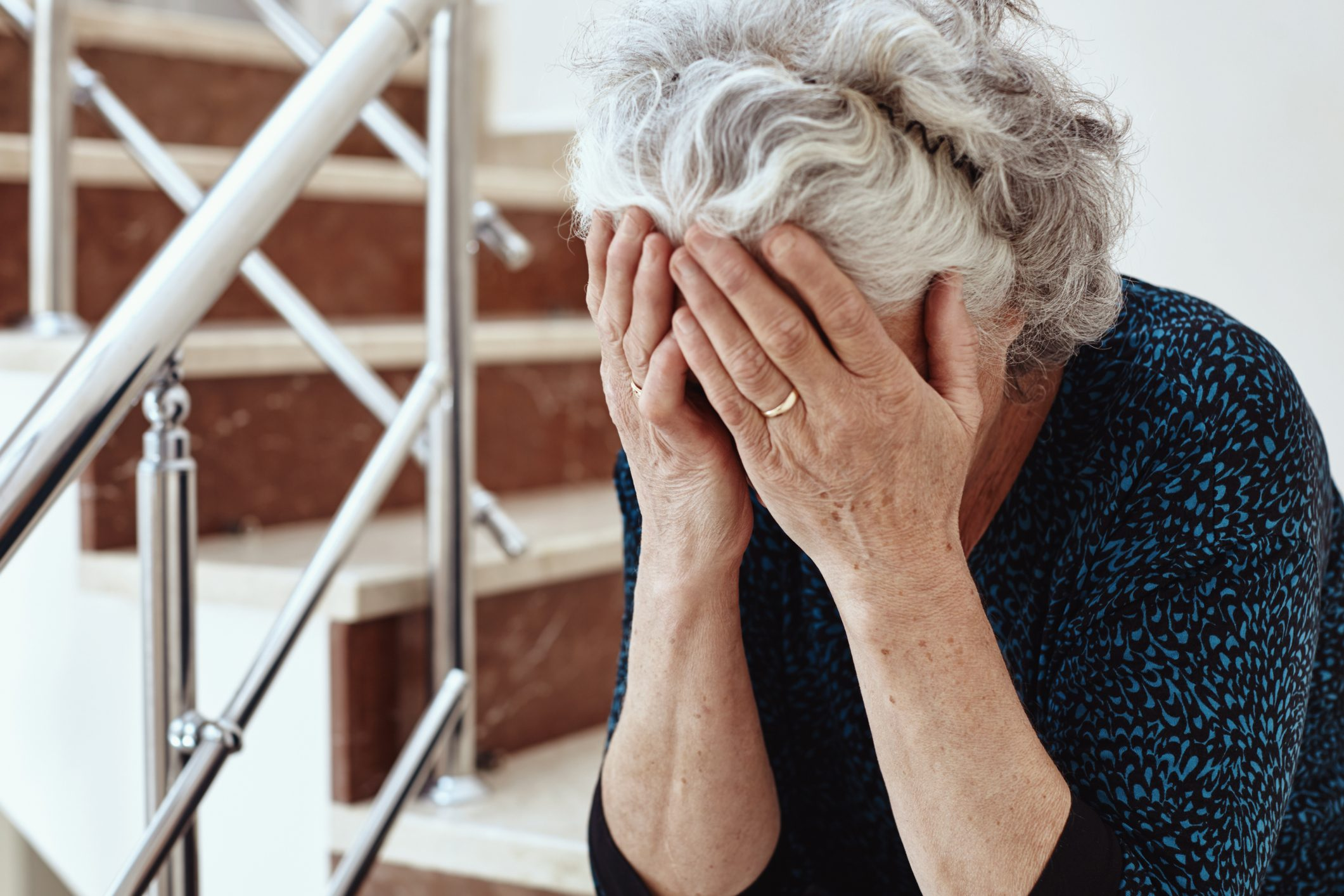 mature woman with her head in her hands