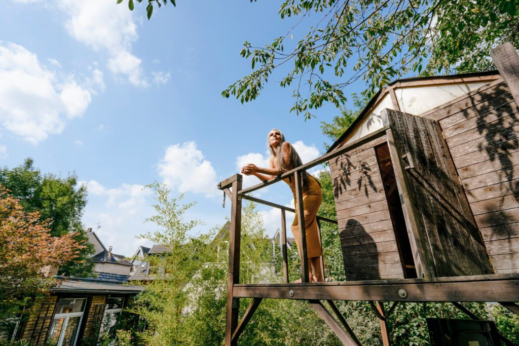 woman standing on treehouse
