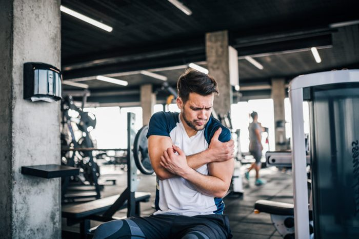 man in pain during workout exercise
