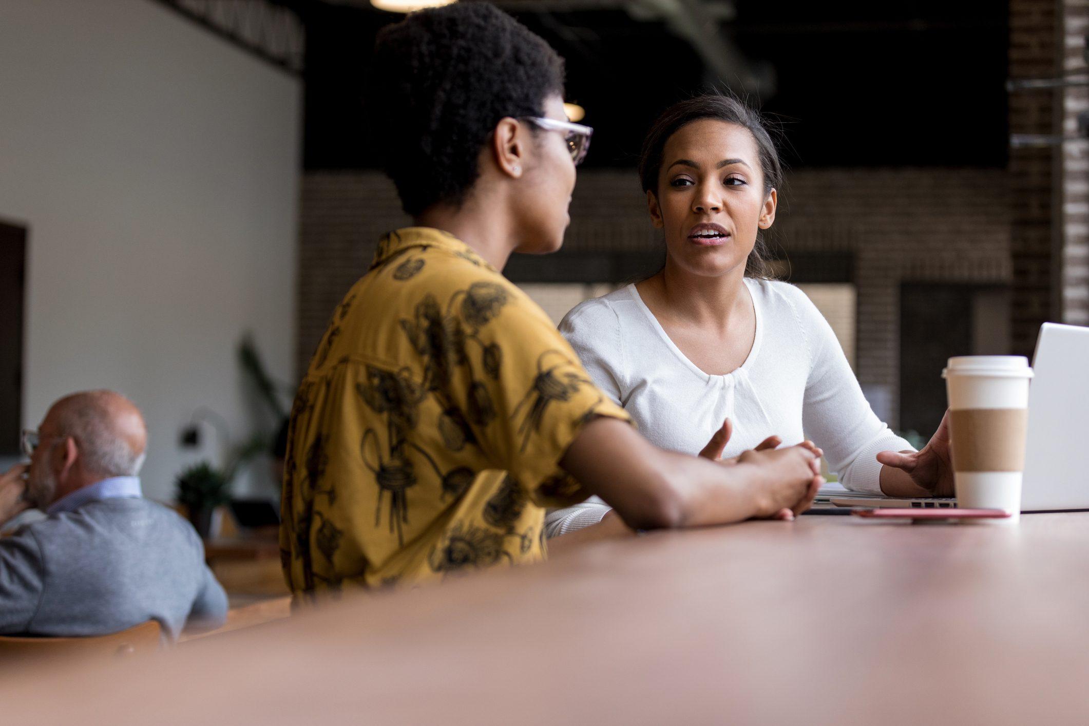 two women friends talking