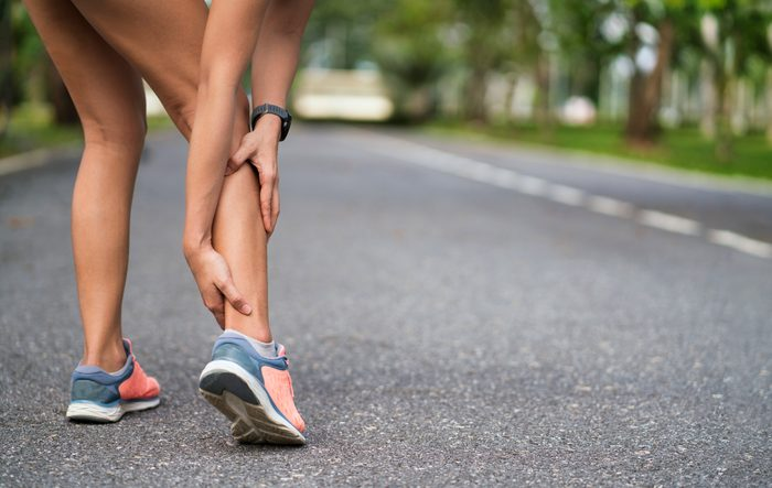 woman with sore leg muscles