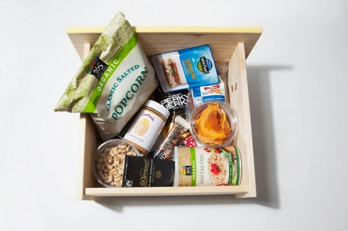 Box of healthy office snacks to keep at your desk.