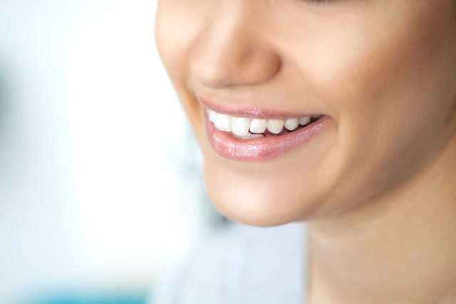 woman's smile showing her teeth