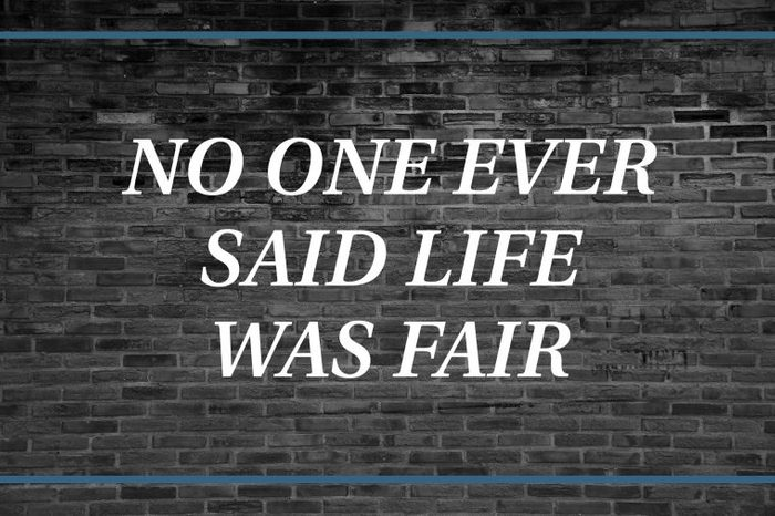 Brick wall background that says: No one ever said life was fair.