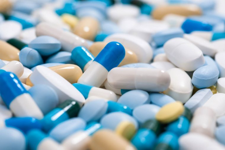 Pile of medications: tablets, pills and capsules.