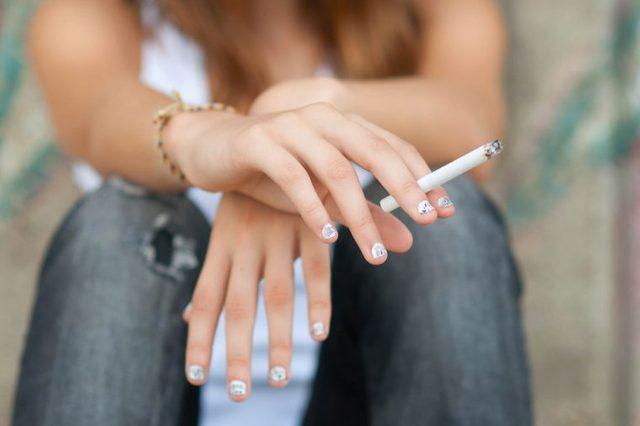 woman holding a cigarette