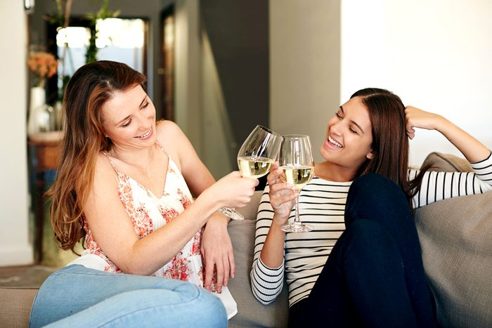 two women drinking and toasting