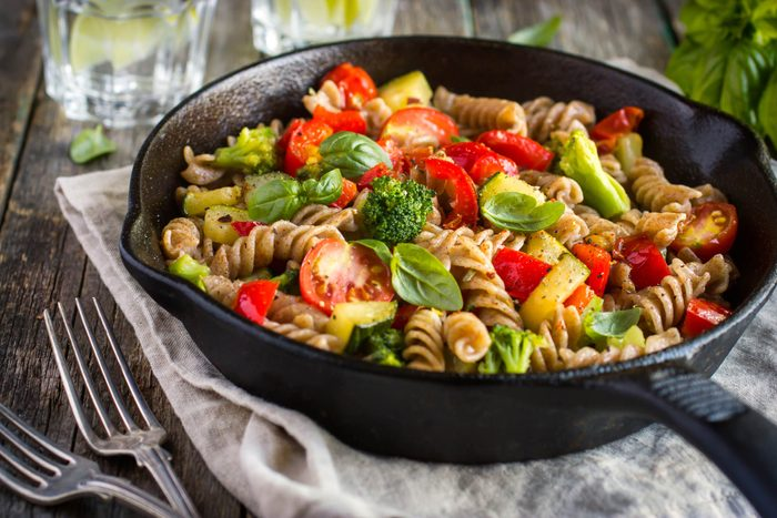 cast iron skillet of pasta and vegetables