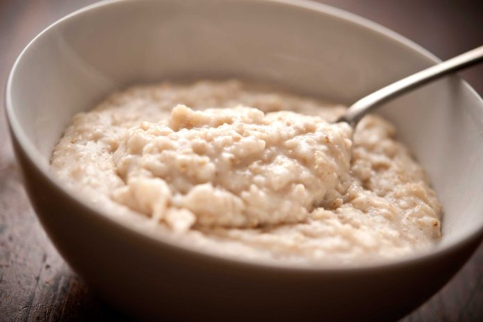 bowl of cooked oatmeal with spoon