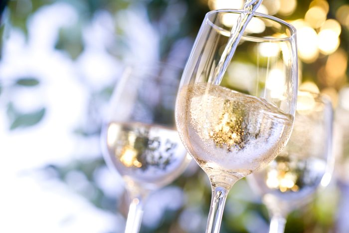 pouring glasses of white wine