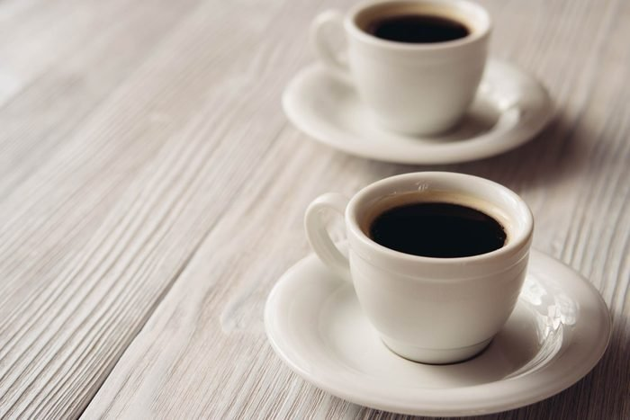 two cups of black coffee