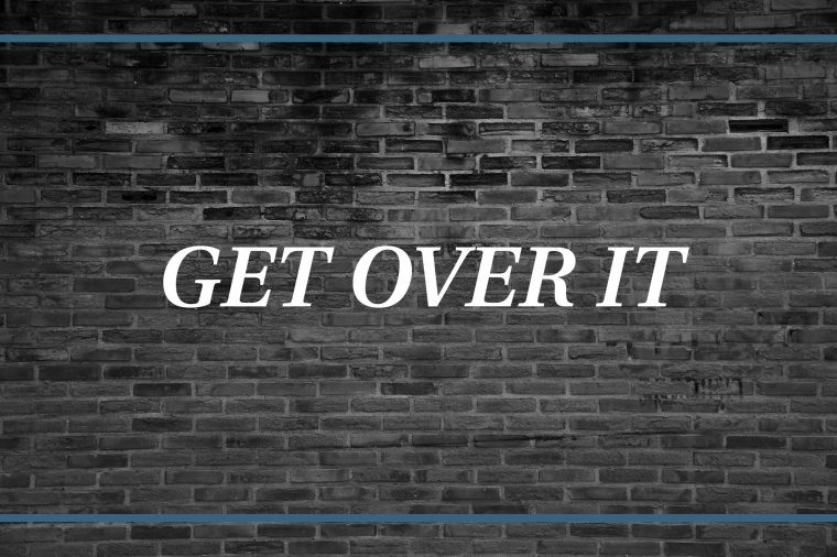 Brick wall background that says: Get over it.