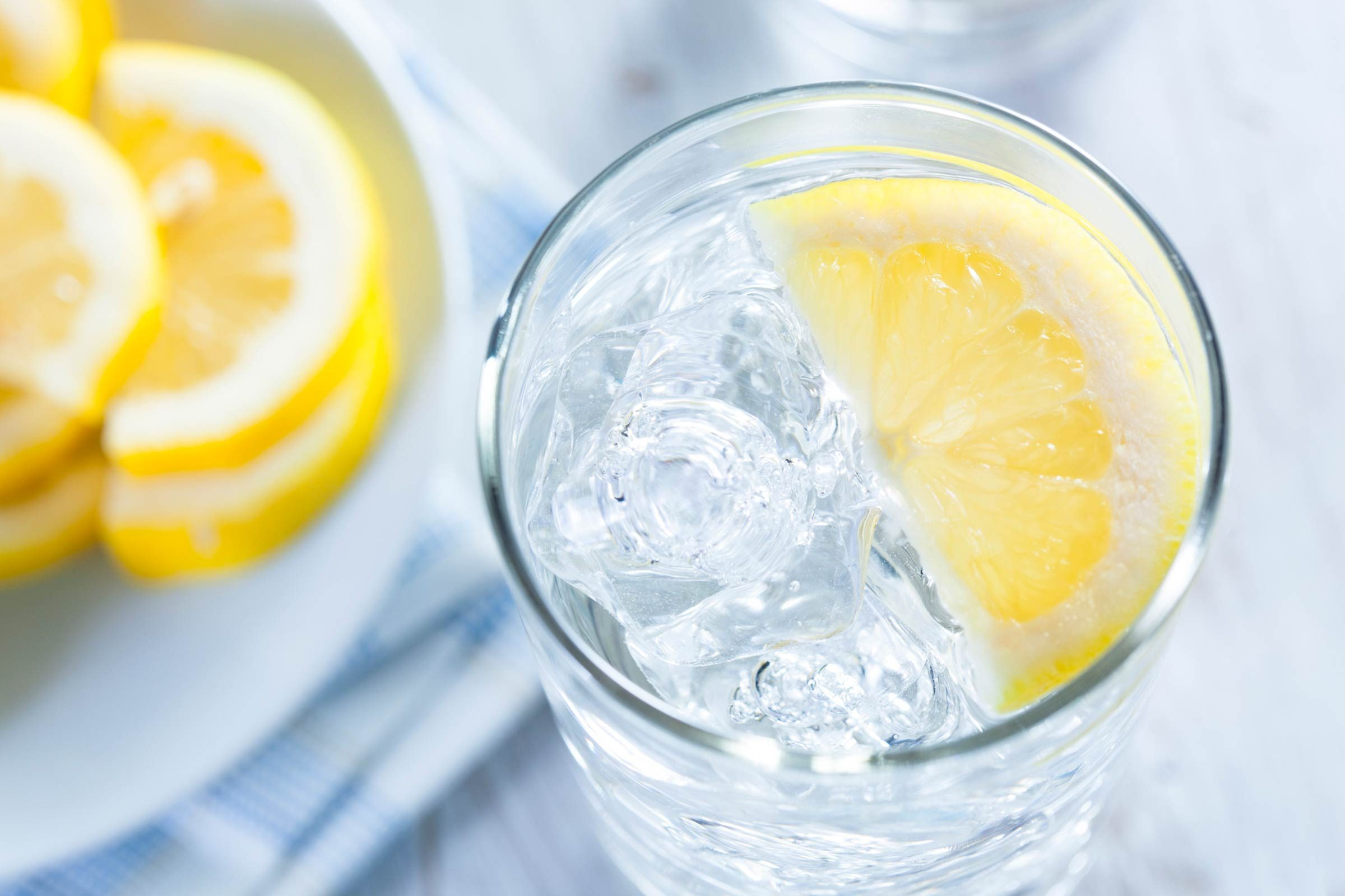 glass of lemon water with ice