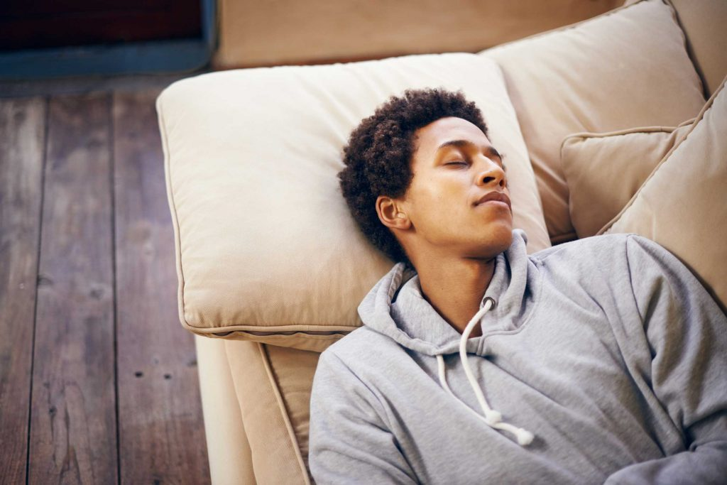 Black man napping on the couch