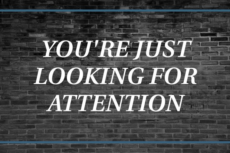 Brick wall background that says: You're just looking for attention.