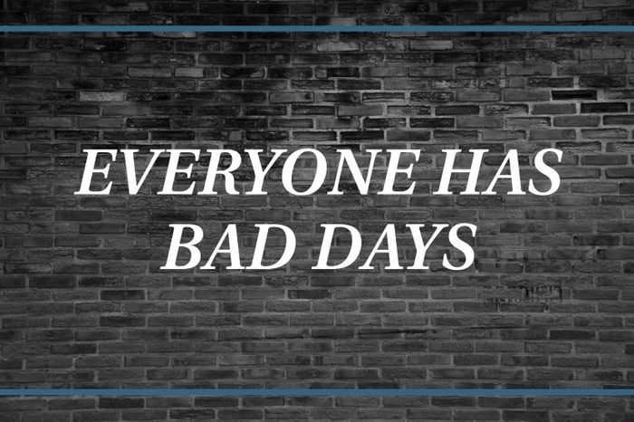 Brick wall background that says: Everyone has bad days.