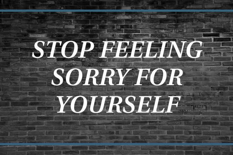 Brick wall background that says: Stop feeling sorry for yourself.
