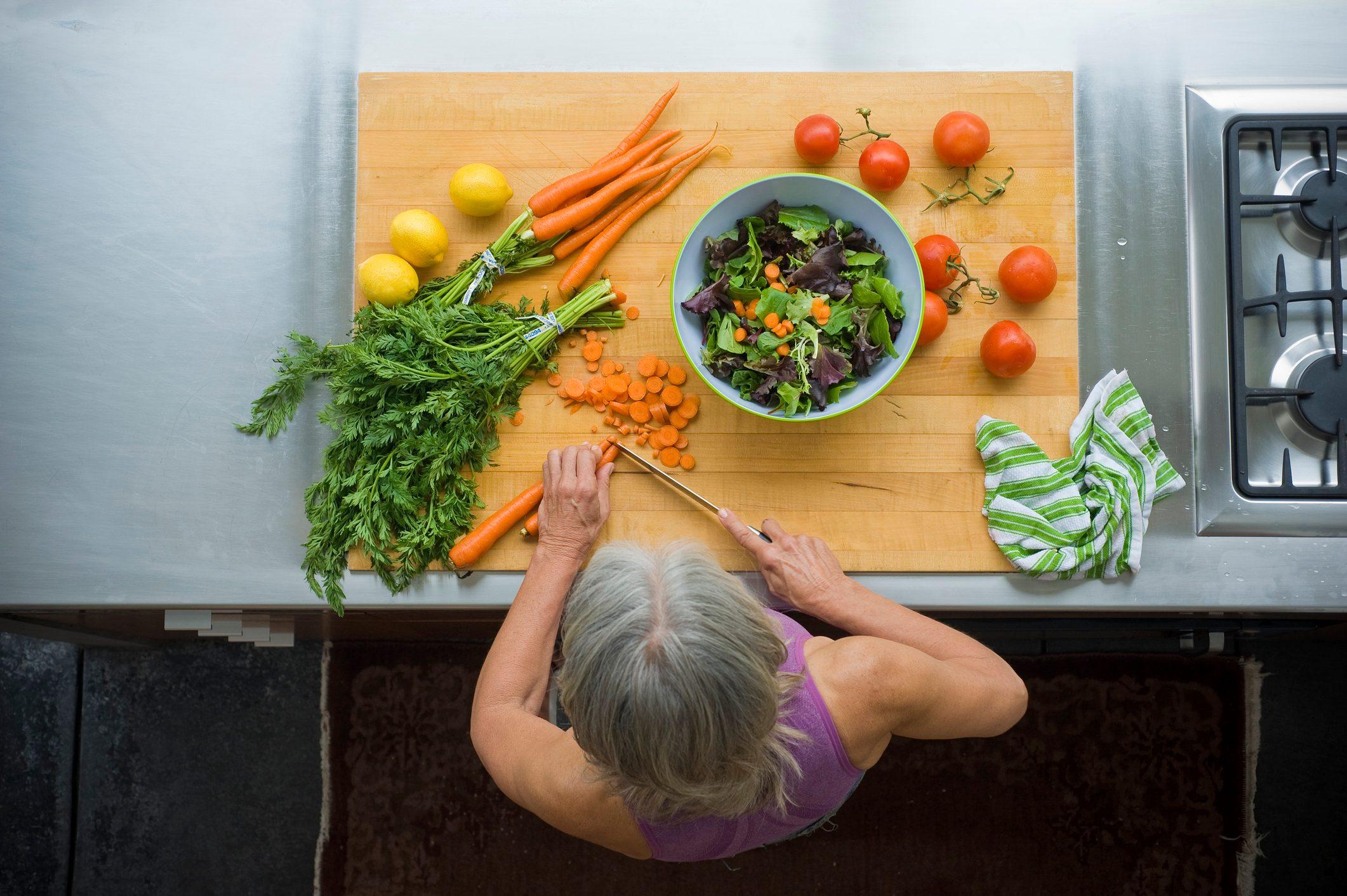 overhead view of woman making a healthy salad