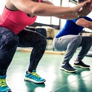 woman squatting exercise gym