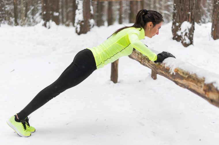 woman in the snow working out