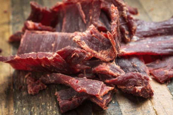 pile of jerky on a wooden table